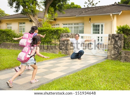 happy father with kids in front of house  - stock photo