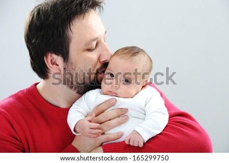 Happy father with newborn baby - stock photo