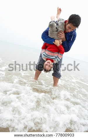 Happy father with son on beach