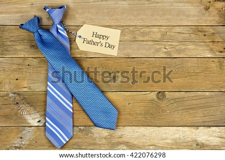 Happy Fathers Day gift tag with blue neckties on rustic wood background                       - stock photo