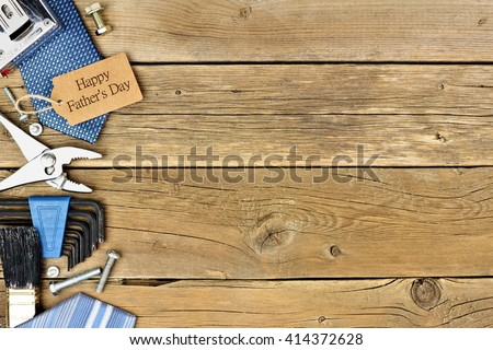 Happy Fathers Day gift tag with side border of tools and ties on a rustic wood background - stock photo