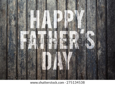 Happy fathers day sign on wooden boards background. - stock photo