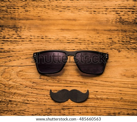 Happy fathers day sticker wooden glasses black paper mustache on wooden background
