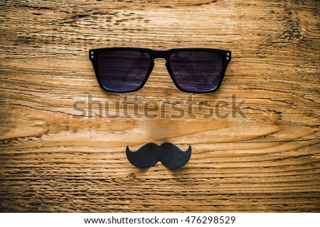 Happy fathers day sticker wooden glasses black paper mustache on wooden background hipster