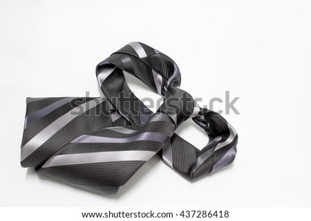 Happy Fathers Day with gray and black striped necktie on white background - stock photo