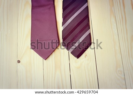 Happy Fathers Day with red, gray and black striped necktie on pine wood background in vintage style - stock photo
