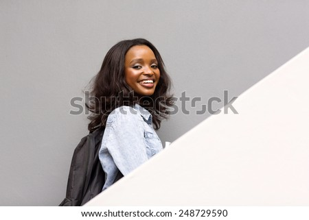 happy female african college girl on campus - stock photo