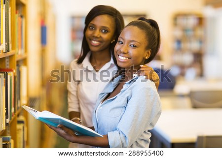 happy female african university students in library - stock photo