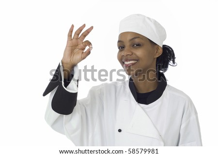 Happy female chef gives the ok or okay sign - stock photo