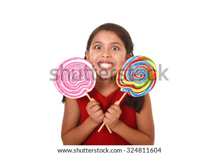 happy female child wearing red dress holding two big lollipop in crazy funny face expression in sugar addiction and kid love for sweet candy concept isolated on white background - stock photo