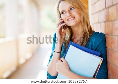 happy female college student talking on mobile phone