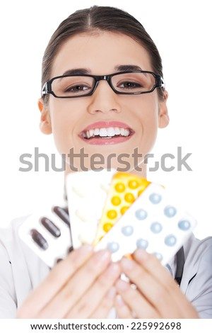 Happy female doctor holding pills - stock photo
