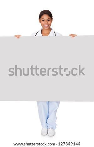 Happy Female Doctor Holding Placard. Isolated On White - stock photo