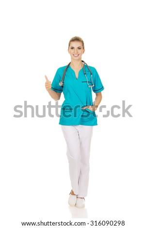 Happy female doctor or nurse with stethoscope. - stock photo