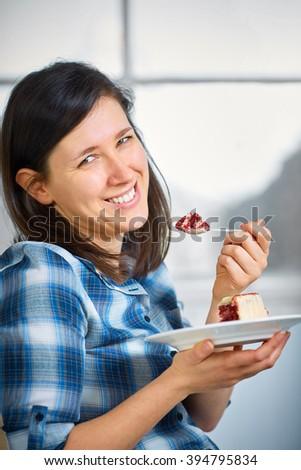 Happy female eat red velvet cake - stock photo