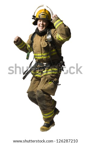 Happy female firefighter dancing
