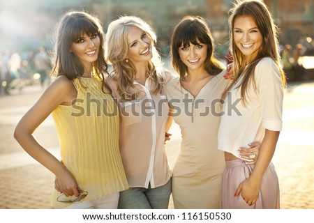 Happy female friends - stock photo
