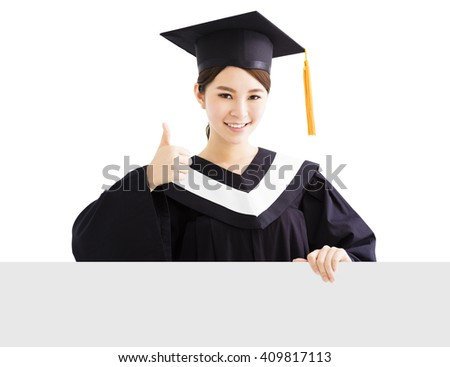 happy female graduate showing   blank board with thumb up