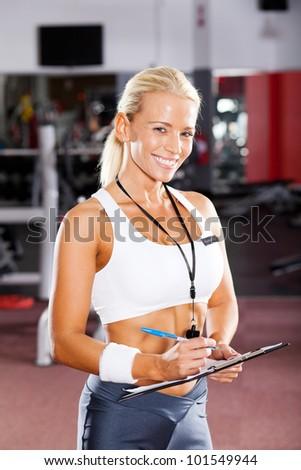 happy female gym instructor portrait - stock photo