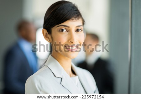 happy female indian business executive in modern office