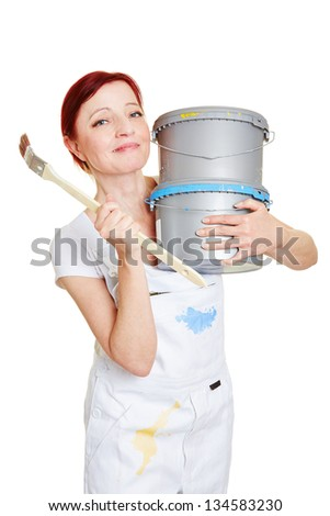 Happy female painter with paintbrush and two paint buckets - stock photo