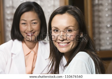 Happy female patient and optometrist
