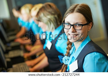 Happy female receptionist worker standing at hotel counter - stock photo