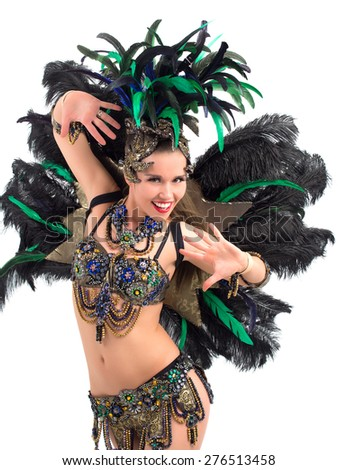 Happy female samba dancer wearing a colorful costume - stock photo