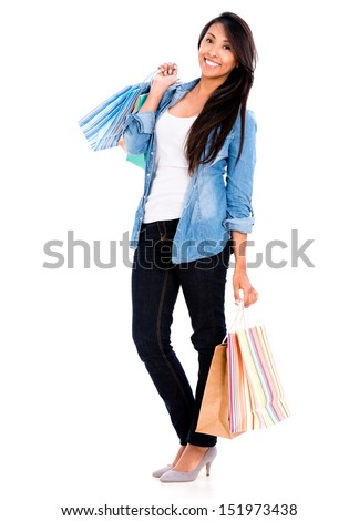 Happy female shopper holding shopping bags - isolated over white  - stock photo