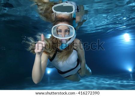 Happy female snorkeler show underwater hand signal  - stock photo