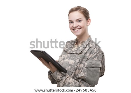Happy female soldier with digital tablet isolated against white background - stock photo