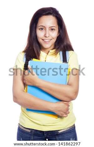 Happy female student carrying notebooks - isolated over a white background