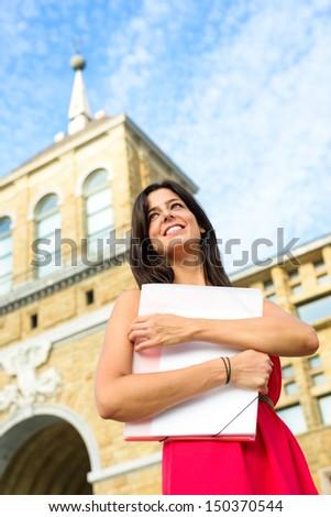 Happy female student in european college campus. Higher education successful woman. Universidad Laboral, Gijon, Asturias, Spain. Girl on university. - stock photo
