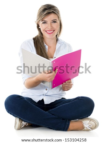 Happy female student sitting down with a notebook - isolated white