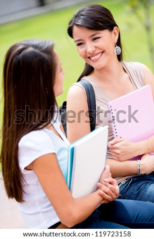 Happy female students talking at the university