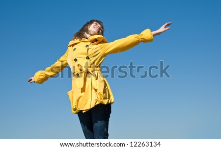 Happy female teenager on the sky background with room for text