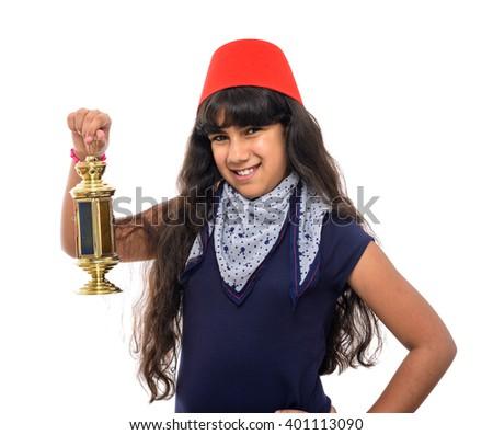 Happy Female Teenager with Fez Holding Ramadan Lantern Isolated on White Background - stock photo