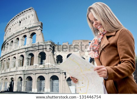 Happy female tourist in Rome holding a map - stock photo