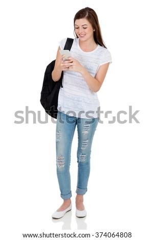 happy female university student using cell phone isolated on white - stock photo