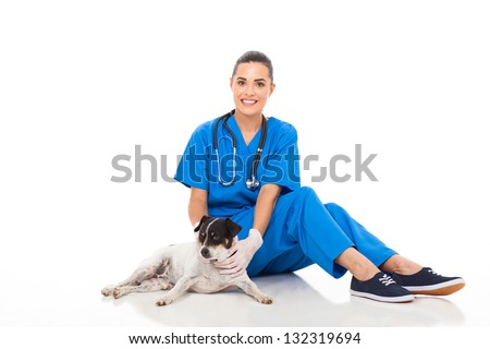 happy female veterinarian sitting with dog isolated on white background - stock photo