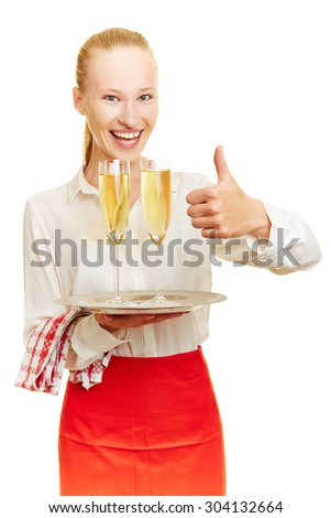 Happy female waiter with sparkling wine holding thumb up - stock photo