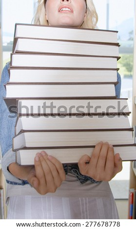 Happy female, young pretty teen student, girl holding books - stock photo