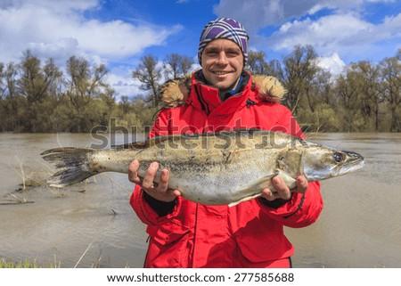 Happy fisherman with big fish. Fishing. Fish perch. Trophy. - stock photo