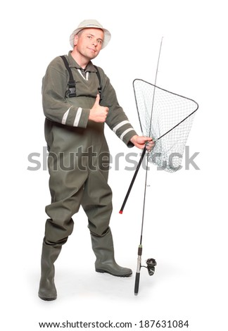Happy fisherman with fishing rod showing thumbs up on a white background. - stock photo