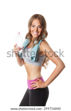Happy fit woman drinking shake after workout - stock photo