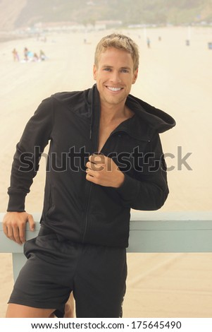 Happy fit young athletic male outside with nice smile - stock photo