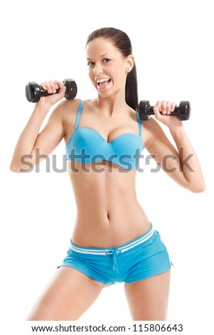 happy fitness girl working out with dumbbells over white background