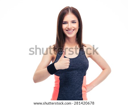 Happy fitness woman showing thumb up isolated on a white background and looking at camera - stock photo