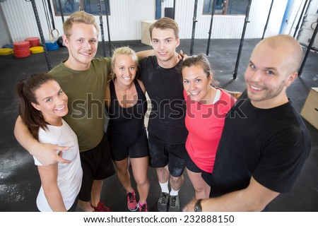 Happy fitness workout team at the gym - stock photo