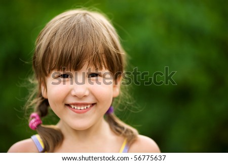 Happy five years Girl smiling outdoors headshot - stock photo